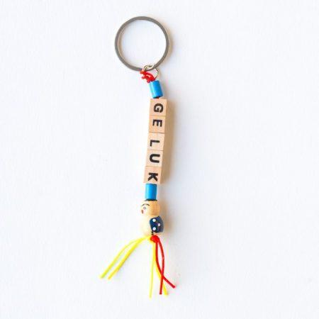 sleutelhanger, sidedish, geluk, gelukspoppetje